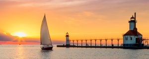 Live Events Stock Media - Lighthouses and Sailboat Soltice Sunset