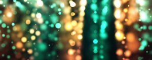 Live Events Stock Media - Glowing Green & Gold Bokeh Orb Particles